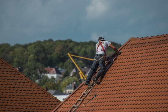 What Are Good Shoes For Roofing - man on the roof