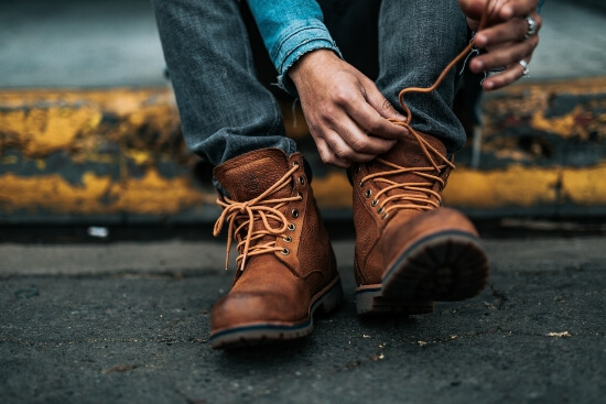 are steel toe dangerous - man tying his laces